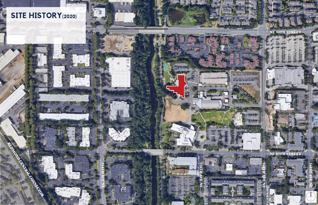 An aerial view shows what downtown Redmond, including the old Redmond Senior Center, looked like in 2020. The view includes city buildings, residences, and the Sammamish River.