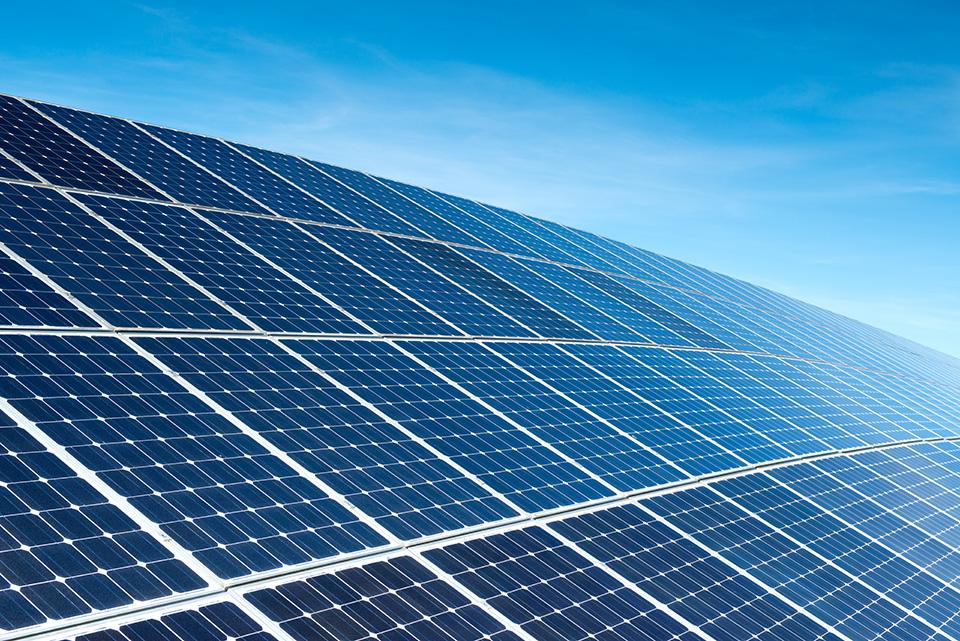 Solar panels reflect in the sunlight.